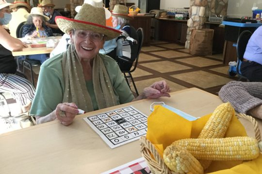 Older lady playing bingo and having fun